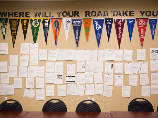 College acceptance letters hang on the wall on Monday, February 27, 2017 at the Education Foundation of Collier County in East Naples. Munro now works with Champions for Learning, a non-profit that pairs kids with retirees who help them study, organize college applications and get jobs.