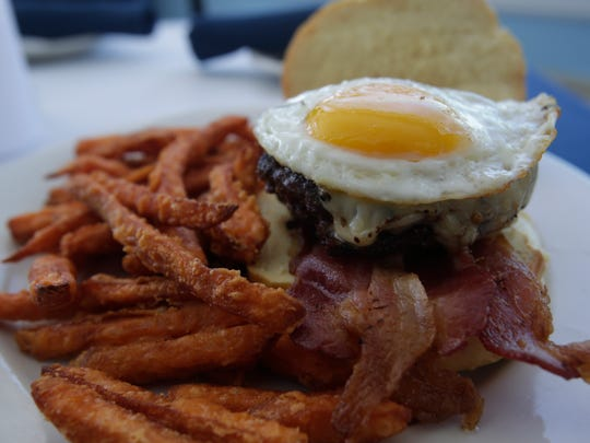 The rise and shine burger with sweet potato fries, one of the plates featured at The Vue Restaurant at the The Inn on the Hudson in Peekskill.