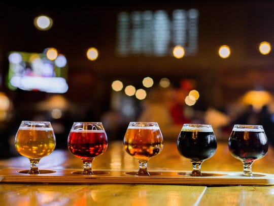 A flight of, from left to right, No Problems, Blackberry IPA, Gilda's Cherry Saison, Bullet Tooth, and Caesar's Gimp on display at Perrin Brewing Company in Comstock Park, Mich. on Thursday, Feb. 23, 2017.