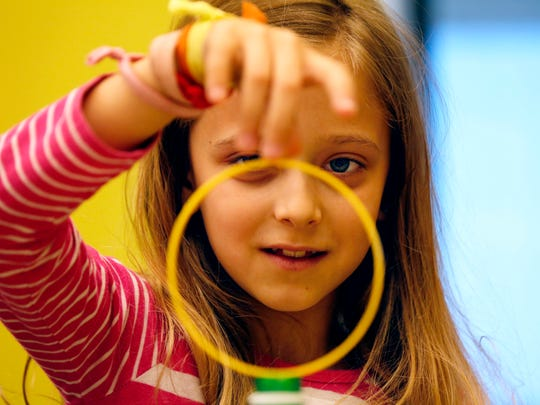 Audrey Messina, 9, practices Newton's first law of motion with a hands-on demonstration during the Homeschool: Funky Physics class at the Golisano ChildrenÕs Museum of Naples on Tuesday, March 21, 2017. Homeschool classes happen on a monthly basis every Tuesday of the month with age/grade specific classes for all ranges of learners.