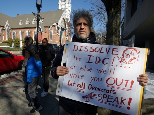 Robert Rendo of Ossining holds a sign at a press conference in front of the offices of New York State Senator David Carlucci in Ossining on Mar. 22, 2017.
