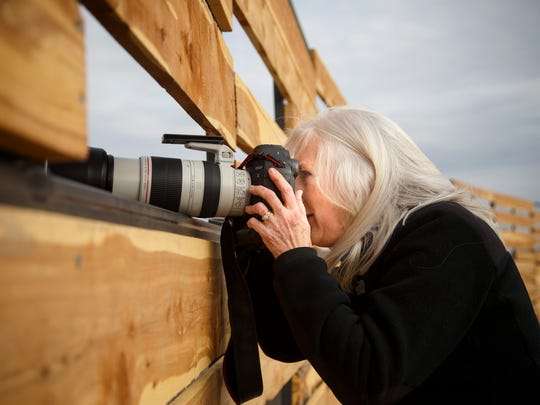 Paula Scherbroeck of Davenport shoots photos near near
