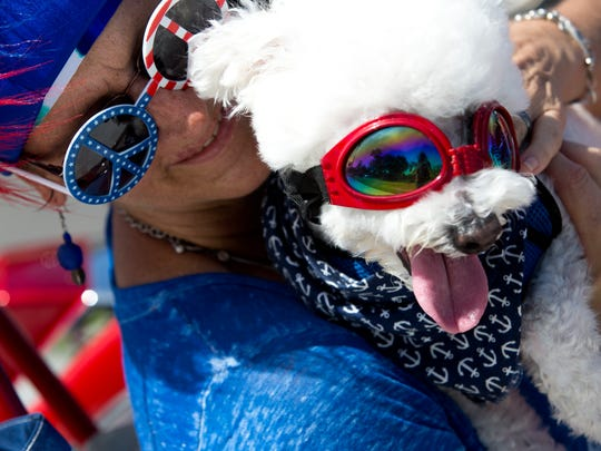 Joyce Goodnoe poses for a portrait with her dog Scooter during the Bonita Springs parade on June 4, 2016.
