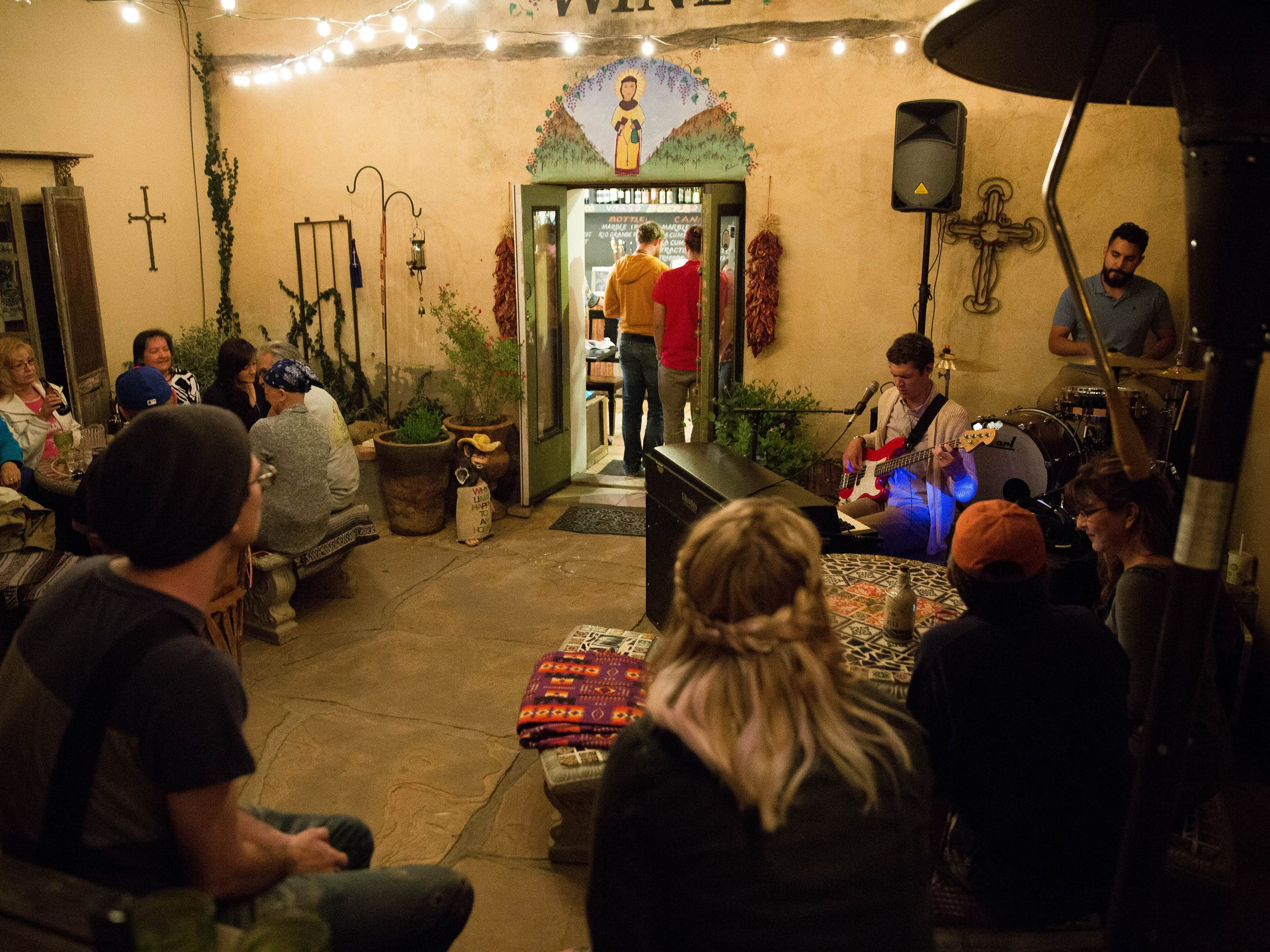 Alexander Wunderlich and Jeremy Gutierrez of Oversoul play at NM Vintage Wines in Mesilla, on Saturday, March 25.