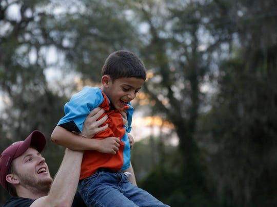Yazan Almasri, 6, gets a ride from volunteer tutor John Searcy during a potluck social at the Islamic Center of Tallahassee on Old Bainbridge Road March 5.