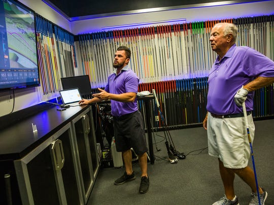 Brandon Collier, left, and client Ed Pappas of Naples, center, work on Pappas' driver checkup at Tour Fit Golf Labs in Naples at the Tiburón Golf Club on Tuesday, March 28, 2017.