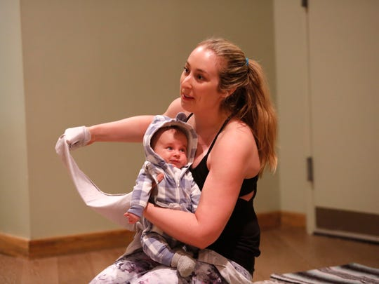 Sarah Laccrrubba of Bronxville with her 8-week-old son Dean at the Mommy and Me Yoga class  at the Riverstone in Tarrytown on Mar. 30, 2017.
