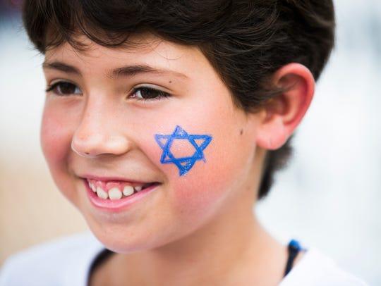 Nerriah Zielinski, 9, smiles after having a star painted