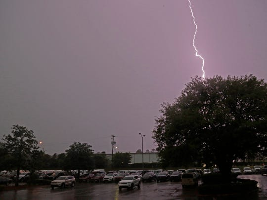 Lightning splits the sky over the Tallahassee Democrat parking lot as severe thunderstorms roll through Tallahassee Monday evening.
