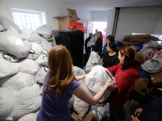 Volunteers with Greater NYC Families for Syria help pack a truck in Eastchester with clothing destined for Syria to aid refugees.
