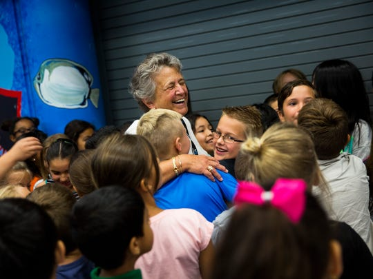 Laura Lehrich, 71, center, smiles as she hugs her students after she received the senior volunteer of the year award at Seagate Elementary on Friday, April 7, 2017. The Outstanding School Volunteer Award is presented annually to a student, adult, and senior volunteer who has shown outstanding dedication and commitment to quality education in Florida.
