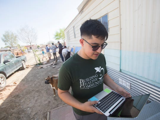 Jorge Reynaga sets up music that is to be listen as part of a selection of artist to be selected for The Hue, an annual music festival in the eastern Coachella Valley.