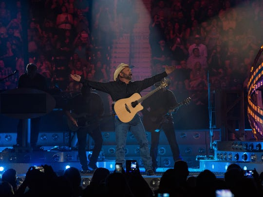 Garth Brooks playing the first of five planned shows