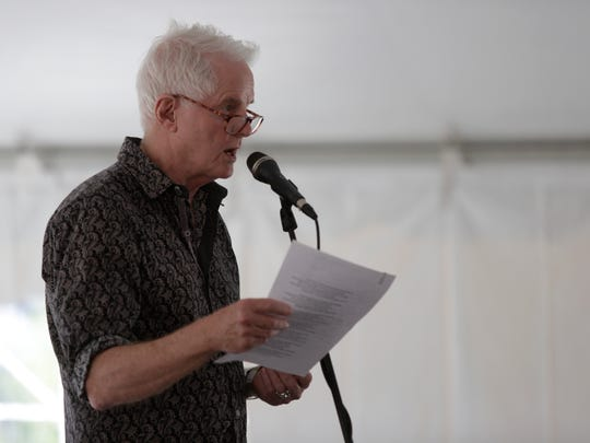 Poet David Kirby reads during a previous  Word of South festival in Cascades Park.