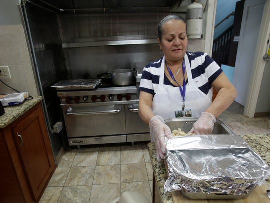 Alba Rivera, a culinary specialist at the St. Joseph Home in Sloatsburg, prepares a meal for the residents on Apr. 10, 2017.