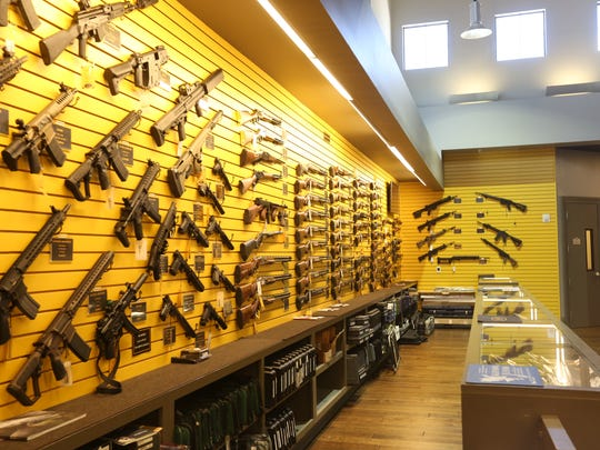 Hundreds of rifles, pistols and shotguns line the walls
