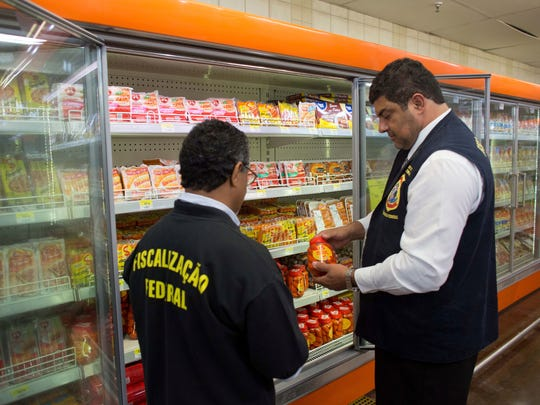 Sanitary inspection agents collect meat products for
