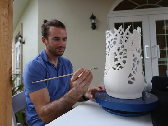 Upriver Ceramics owner Matt Kearney glazes an intricate vase during the Bloom Art Opening Reception. He's become a regular at the Historic Shangri-La Springs.