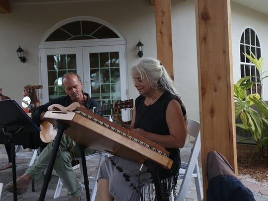 Debo Kumi plays the hammered dulcimer accompanied by Rick Alpert on the Bloom Art Opening Reception at the Historic Shangri-La Springs.