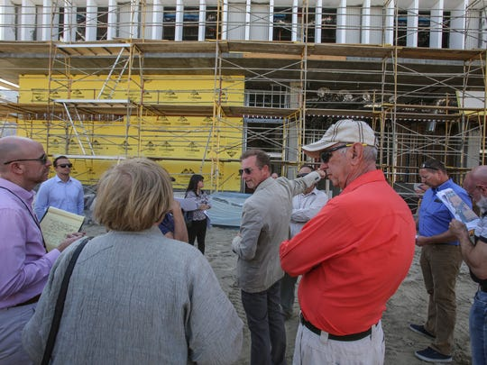 Michael Braun, president of Wessman Development, center, lead members of the City of Palm Springs Planning Department on a tour of the construction site of the downtown Palm Springs redevelopment project on Thursday, April 13, 2017.
