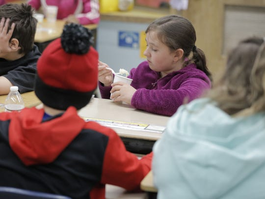 Ava Galles gets ready to try sauerkraut during the Farm to School lesson Thursday, April 13, 2017, at Webster Stanley Elementary School. The Winnebago County Health Department goes to schools to expose students to different food and lessons of a healthy nature.