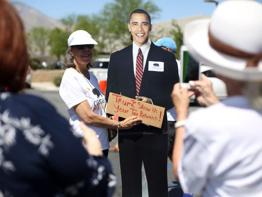 A cutout of President Barack Obama was popular for use in photos during an April 2017 protest where about 200 people gathered outside the Internal Revenue Service office in Palm Springs demanding that President Donald Trump release his tax returns.