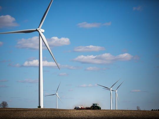 Wind turbines fill the horizon near Ida Grove Thursday, April 6, 2017.