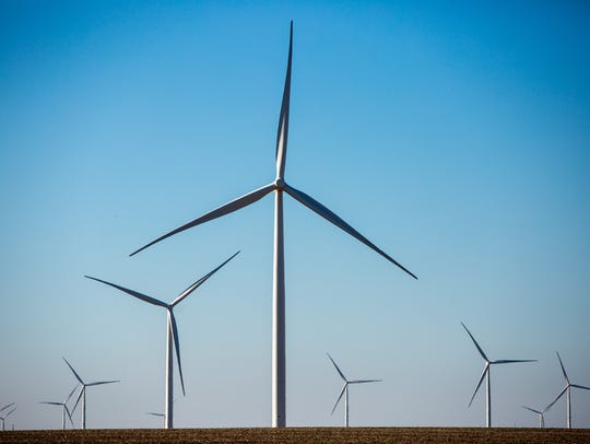 Wind turbines fill the horizon in O'Brien County Thursday,