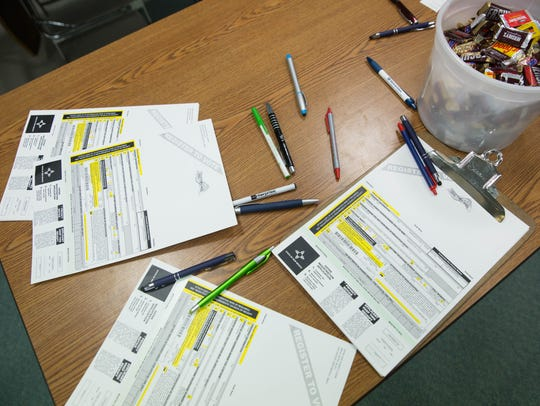 Voter registration cards lay out waiting for Oñate High School students in 2017.