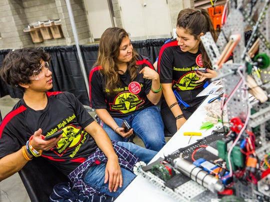 From left, Immokalee High School Robotics Team senior Kristian Trevino, junior Linda Hernandez, and senior Jenni Villa take a break in between matches during the Vex Robotics Competition World Championship in Louisville, Ky. on Thursday, April 20, 2017. This is day one of three days of competition for the students.