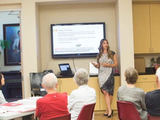 Tiffany Dalton, nutritionist, gives a speech at Gilda's Club Desert Cities as part of a special cooking and wellness class aimed at cancer patients.