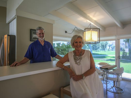 Husband and wife realtors Geri and Steve Downs with
