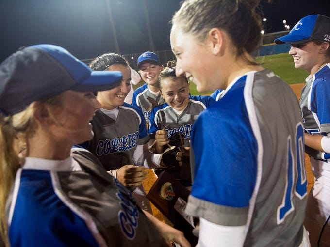 The Barron Collier girls' softball team celebrates