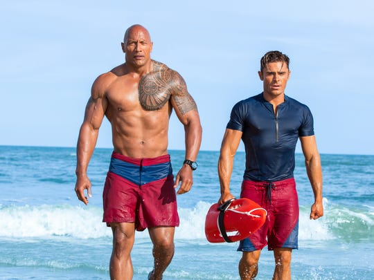 """David Hasselhoff never looked like this. Dwayne Johnson (left) and Zac Efron star in """"Baywatch."""""""