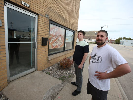 Ian Wenger, left, and Zach Clark, owners of Fifth Ward Brewing Co., pose Tuesday, April 25, 2017, outside the building they are renovating at 1009 S. Main St. to turn it into a craft brewery and sampling room. They aim to educate the community on micro breweries and what they have to offer.