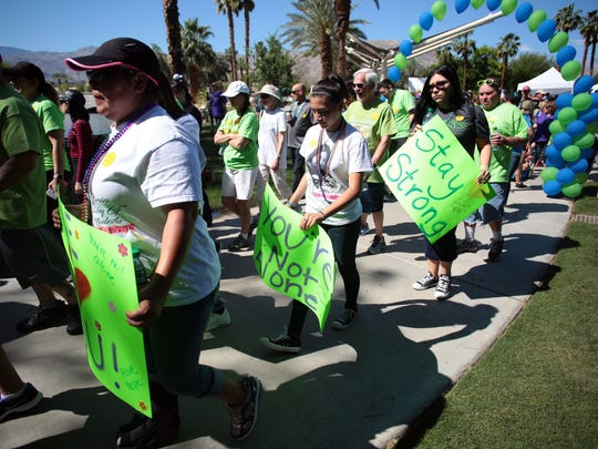 Hundreds came out on a warm Saturday to take part in the Out of Darkness Suicide Awareness Walk, an annual walk/fundraiser to raise awareness about suicide and mental health.
