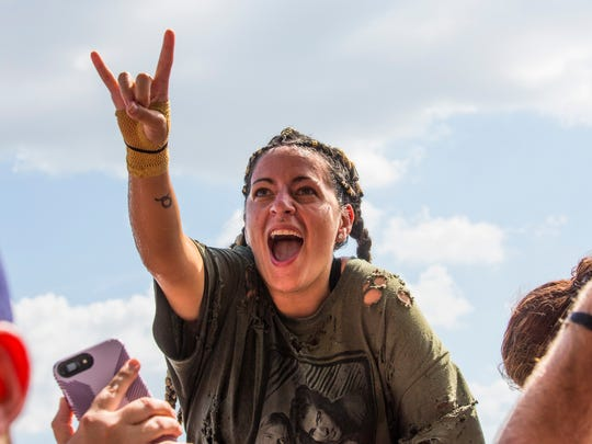 A woman rocks in the crowd as the bands played. What the Fort Rock festival means to fans and to the bands who are booked to play in it. What is the economic impact to Lee County, and how the festival came to be as well.