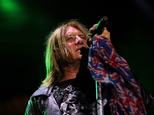 Joe Elliott of Def Leppard performs before thousands at Fort Rock on Saturday night.