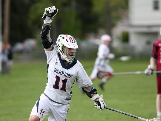 Wappingers's James Pratt celebrates during a 12-7 win