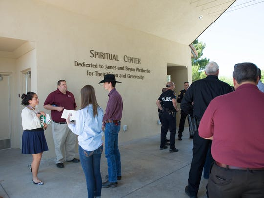 Family and friends of New Mexico State University students, faculty and staff gather outside of the Spiritual Center after a memorial services for students, faculty and staff who have passed over the past year, Wednesday, May 3, 2017.