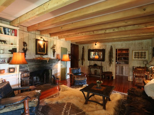 The living room of the Adirondack camp style home on