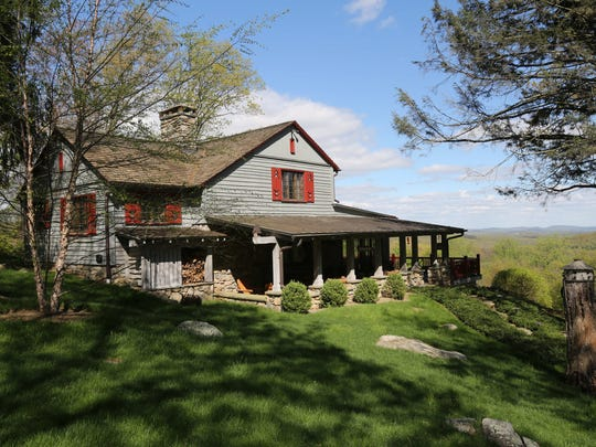 The exterior of the Adirondack camp style home on 4