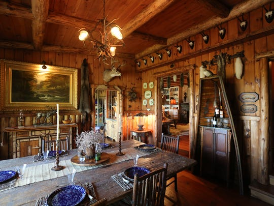 The dining room at the Adirondack camp style home on