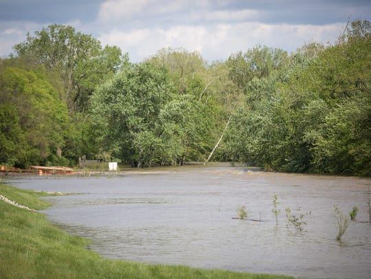The White River is shown overflowing its banks after several days of rain from a past spring.
