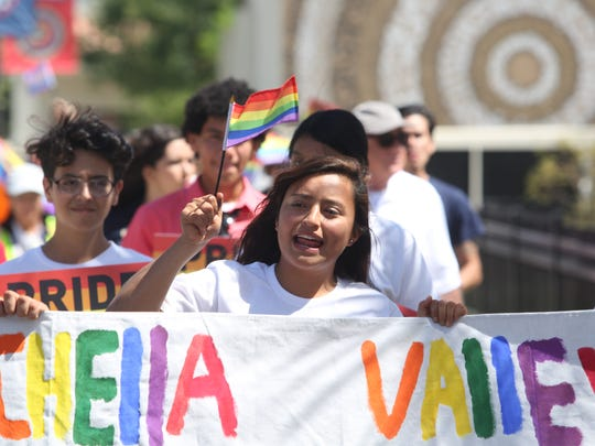Liliana Vallejo, 18, a student of Desert Mirage High School leads the first annual Pride Festival march in the city of Coachella in support of the LGBTQ community of the Eastern Coachella Valley at Veteran's Park on May 6, 2017.