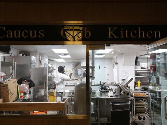 The kitchen of Detroit's Caucus Club is visible from