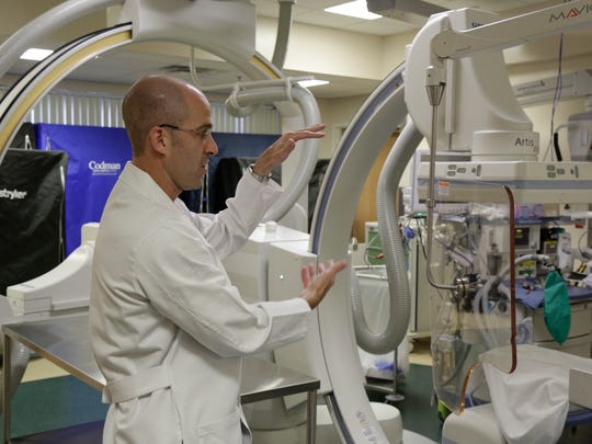 Neurosurgeon Dr. Matthew Lawson explains some of the technology in the catheterization lab at TMH May 1.