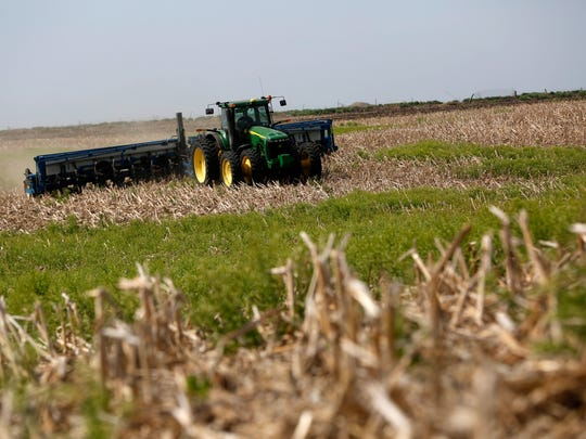 Michael Fritch plants soybeans Tuesday, May 9, 2017