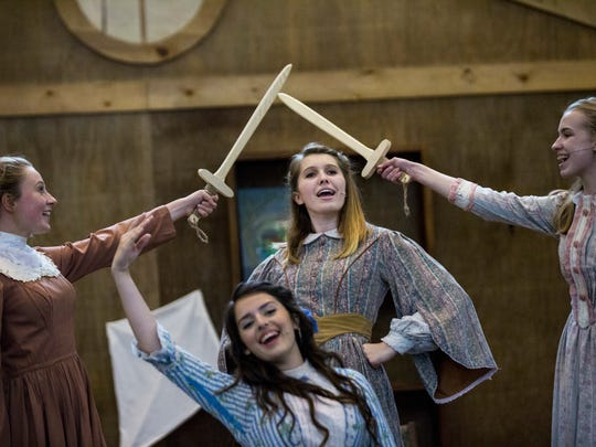 """Athena Kelley, 16, center, sings alongside Grace Rucker, 15, from left, Faith Hundley, 16, and Lauren Tayon, 14, during a rehearsal for The Village School of Naples' production of """"Little Women"""" at North Naples United Methodist Church on Monday, May 8, 2017."""