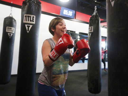 Reporter Ashley Collins enjoys a 60 minute boxing class at Title Boxing Club in Naples on May 9, 2017. The Club also offers kickboxing and boxing for Parkinson's disease.